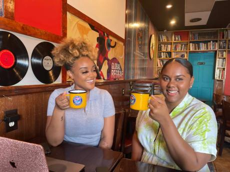 Diners enjoy island-inspired libations from enamel cups, another Jamaican touch boasted by Coffee Bay Restaurant.