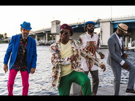 From left: Third World's Norris Webb, A.J. Brown, and Richard Daley share the 'feel good' energy with Busy Signal, who was named the 2020 Dancehall Artiste of the Decade as they shoot scenes for their music video in Miami.