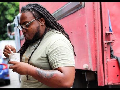 Long-time supporter of Mama Bev's soup spot, Fabian McKenzie, may not be a fan of cow skin, but he enjoys the flavours it adds to the red peas, peanut soup.
