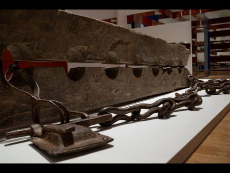 Tronco, or multiple foot stocks used to constrain enslaved people, are seen at the Slavery exhibition Rijksmuseum in Amsterdam, Netherlands, Monday, May 17, 2021.