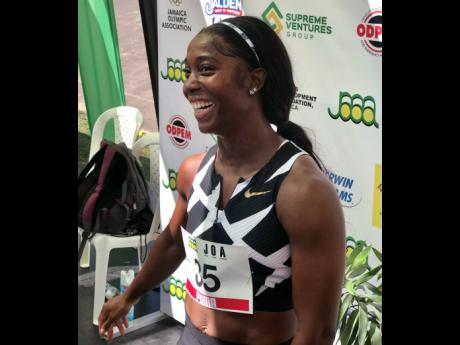 Shelly-Ann Fraser-Pryce is all smiles after clocking 10.63 seconds to win the 100m at the JOA/JAAA Olympic Destiny Series at the National Stadium yesterday. The time is a new national record and the second fastest time in the event in history.