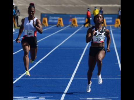 Shelly-Ann Fraser-Pryce (right) crosses the finish line ahead of Natasha Morrison to clock a national record of 10.63 seconds in the women's 100m sprint at the JOA/JAAA Olympic Destiny Series at the National Stadium on Saturday.