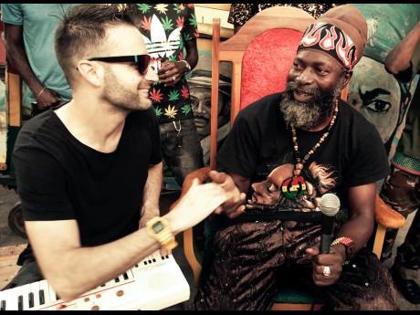 Manudigital (left), and veteran reggae-dancehall artiste Capleton.