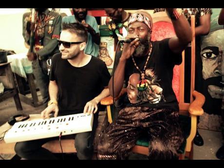 Manudigital feeds off veteran reggae-dancehall artiste Capleton's energy to bring more fire into the Kingston digital sessions.