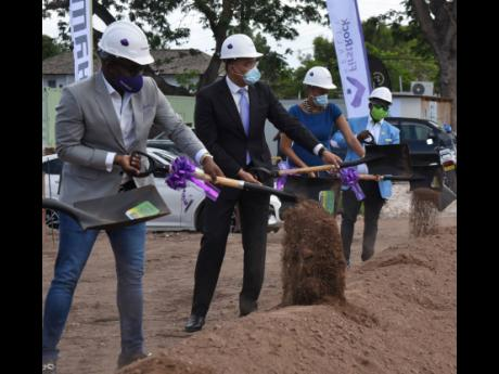Prime Minister Andrew Holness (second left) break grounds for First Rock Capital Holdings' Hambani Estates housing development with Ryan Reid (left), co-founder and group CEO, First Rock; St Andrew Eastern Member of Parliament Fayval Williams (second rig