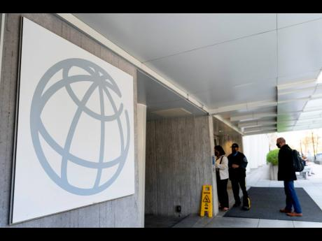 People enter the World Bank building in Washington.
