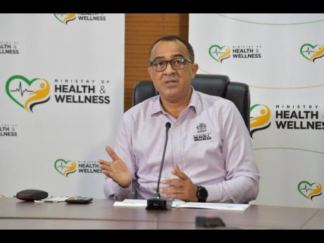 Minister of Health and Wellnes Dr Christopher Tufton.