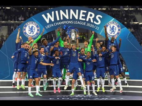 Chelsea's team captain Cesar Azpilicueta lifts the trophy at the end of the Champions League final match between Manchester City and Chelsea at the Dragao Stadium in Porto, Portugal, Saturday, May 29, 2021. Chelsea won the match 1-0.