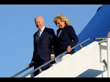 President Joe Biden and first lady Jill Biden step off Air Force One at RAF Mildenhall in Suffolk, England yesterday.