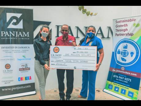 Anna Ward (left), executive director of the C.B. Facey Foundation, presents a cheque valued at $1 million to Andre Gooden (centre), group business development manager at the Jamaica Stock Exchange, and Nora Blake, project manager of the Jamaica Social Stoc