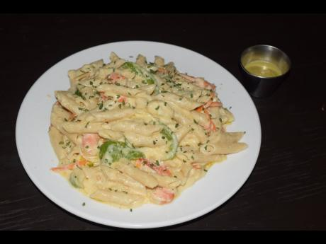 The Creamy Shrimp Alfredo Penne Pasta, served with a special 'bun fire' and a garlic aioli sauce.