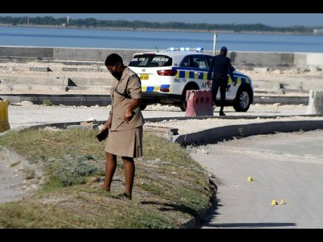 Police officers investigating a shooting incident near the Rae Town fishing village on Wednesday after four people were shot by unknown assailants.
