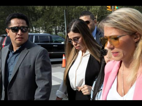 In this July 17, 2019 photo, Emma Coronel Aispuro (centre), wife of Mexican drug lord Joaquin 'El Chapo' Guzman, arrives for his sentencing at Brooklyn federal court, in New York.