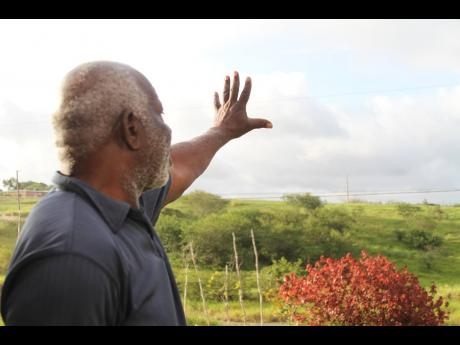 Edward Anderson, a residents of Bethel Isles, Manchester, who was relocated by bauxite company Jamalco in 2005, is yet to receive titles for his land.
