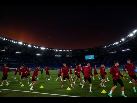 Turkey players warm up during a training session of the national football team at the Olympic Stadium in Rome yesterday, ahead of their match against hosts Italy today.