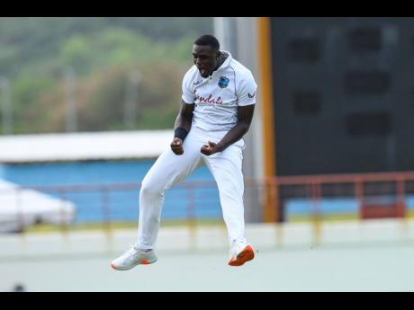 West Indies bowler Jayden Seales celebrates after taking a wicket on debut against South Africa on Day One of their first Test at the Daren Sammy National Stadium in Gros Islet, St Lucia, yesterday.