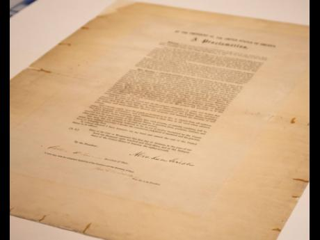 This updated handout photo provided by the Abraham Lincoln Presidential Library and Museum on Tuesday, June 8, 2021 shows a signed copy of Emancipation Proclamation.