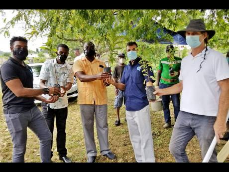 From left: Sherrón Barker, fishing manager at Food For The Poor (FFTP) Jamaica; St Ann's Bay Deputy Mayor Dalas Dickenson; Councillor Ian Bell; Nakhle Hado, director, agriculture and fishing, FFTP; and Simon Stewart, secretary, Ocho Rios Nature Preserve