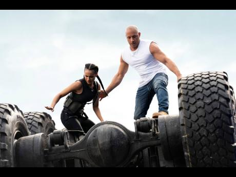 This image released by Universal Pictures shows Nathalie Emmanuel (left), and Vin Diesel in a scene from 'F9'.