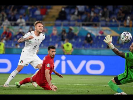 Italy's Ciro Immobile (left) scores his side's second goal during the Euro 2020, football championship Group A match between Italy and Turkey, at the Rome Olympic Stadium yesterday. Italy won 3-0.