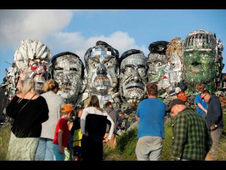 People look at artwork called Mount Recyclemore.