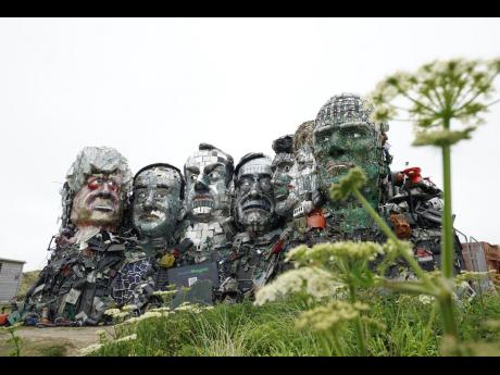 A sculpture created out of e-waste in the likeness of Mount Rushmore and the G7 leaders on a hill in Hayle, Cornwall, England.