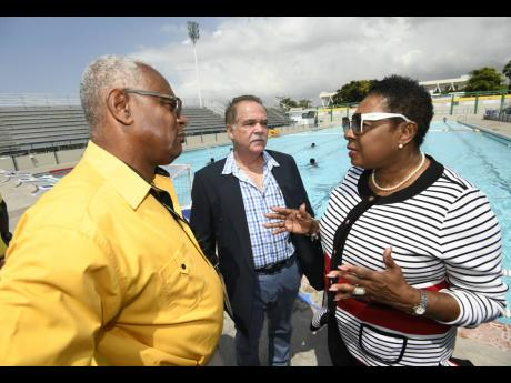 Minister of Sport Olivia Grange with Major Desmon Brown (left), general manager, Independence Park Limited, and Martin Lyn, president of the Aquatic Sports Association of Jamaica, at the National Aquatic Centre.