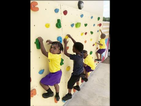 It's rock climbing time for students of the Savanna-la-Mar Inclusive Infant Academy.