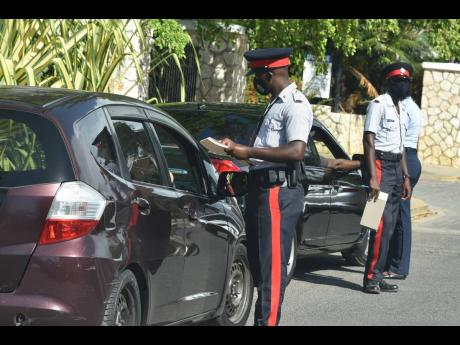Police officers on duty in the resort town of Falmouth, Trelawny