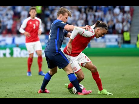 Finland's Rasmus Schueller fights for the ball with Denmark's Yussuf Poulsen (right) during the Euro 2020 championship Group B match between Denmark and Finland at Parken Stadium in Copenhagen. Finland won 1-0.