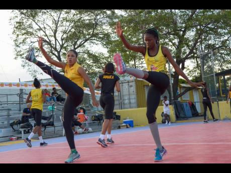 Sunshine Girls Adean Thomas (left) and Nichole Dixon go through their  paces during a training session at the Leila Robinson Courts at the National Stadium on June 5, 2019.