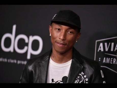Pharrell Williams' non-profit plans to open a group of small private schools for students from low-income families, starting in Norfolk.