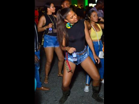 A fan came out to Strictly 2K Best of the 2000s Dancehall at Mas Camp, Stadium North, in 2019.