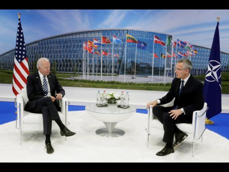 NATO Secretary General Jens Stoltenberg (right), speaks with US President Joe Biden during a bilateral meeting on the sidelines of a NATO summit at NATO headquarters in Brussels yesterday. Biden is taking part in his first NATO summit, where the 30-nation