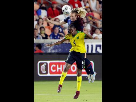 US midfielder Samantha Mewis (top) and Jamaica midfielder Vyan Sampson go up for a header during the second half of their Summer Series international friendly match at the BBVA Stadium in Houston, Texas, on Sunday.