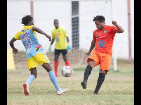 Waterhouse FC's Rafiek Thomas (left) challenges Tivoli Gardens' Ranike Anderson for the ball during a Jamaica Premier League game at the Edward Seaga Sports Complex, on Sunday, February 23, 2020.