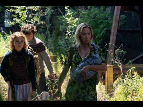 Emily Blunt (right), Millicent Simmonds and Noah Jupe star in 'A Quiet Place 11'.