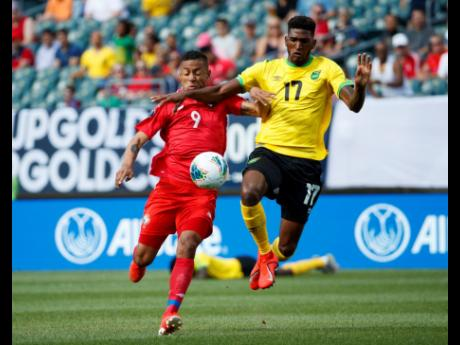 Jamaica's Damion Lowe (right) and Panama's Gabriel Torres battle for the ball during the first half of a Concacaf Gold Cup match in Philadelphia in 2019. Jamaica won 1-0.