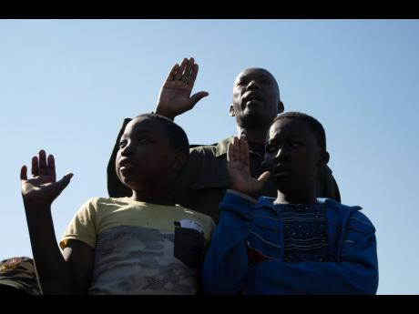 People attend a commemoration at the Hector Petersen Memorial in Soweto on the 45th anniversary of the Soweto uprising Wednesday, June 16, 2021.  (AP)