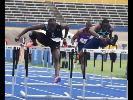 Rasheed Broadbell (left) clears the final hurdle in the Men's 100 metres hurdles ahead of  Ronald Levy (right) during the JOA-JAAA Olympic Destiny  series track meet at the National Stadium on Saturday, May 22, 2021.