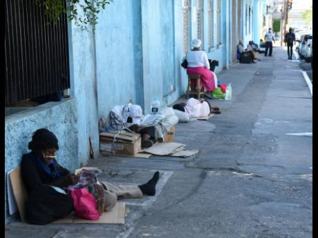 Homeless persons seen along Church Street in downtown Kingston on May 4. Six homeless people have died after targeted attacks.