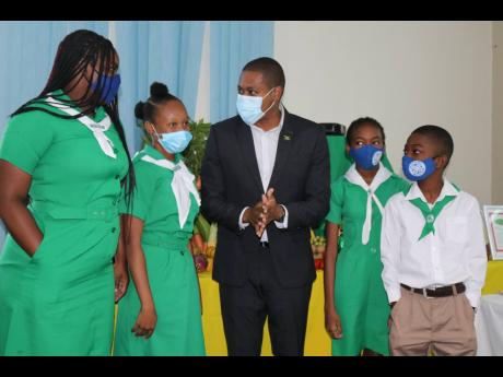 Minister of Agriculture and Fisheries Floyd Green raps with clubbites from Papine High School (from left), Zidanie McCalphin, Rhianna Simpson, Destiny Minto and Kristoff Minto, at the virtual launch of the Jamaica 4-H Clubs Virtual Achievement Day Expo, he