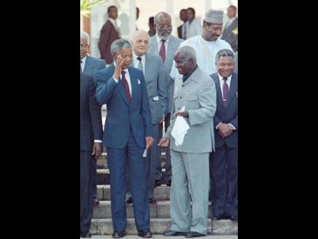 South Africa's Nelson Mandela (left) joins Zambia President Kenneth Kaunda in Lusaka in 1990, after meeting with seven African presidents and commonwealth leaders.