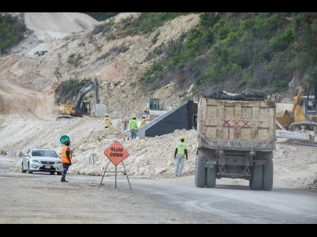 Construction work under way along the Southern Coastal Highway Improvement Project on Monday, April 5. Residents of Grants Pen in St Thomas are concerned that road bypassing of their community could threaten its survival.