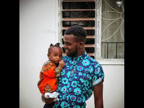Reggae-dancehall rising star Yaksta is filled with humility and joy as he looks at Ahjza at nine months old.