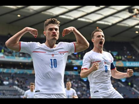 Czech Republic's Patrik Schick (left) celebrates after scoring his side's first goal from the penalty spot during the Euro 2020 Group D match between Croatia and the Czech Republic at the Hampden Park stadium in Glasgow, Scotland, yesterday.
