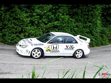 The late Macklin Peterkin competing at a staging of the Mandeville Tarmac Rally.