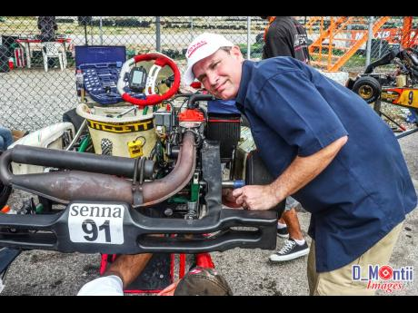 Veteran racer David Summerbell wearing the hat of crew chief for son, Senna, at a karting event.