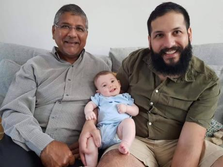 (From left) British High Commissioner to Jamaica  Asif Ahmad, with his fourth month old grandson Joshua and his son Adam.