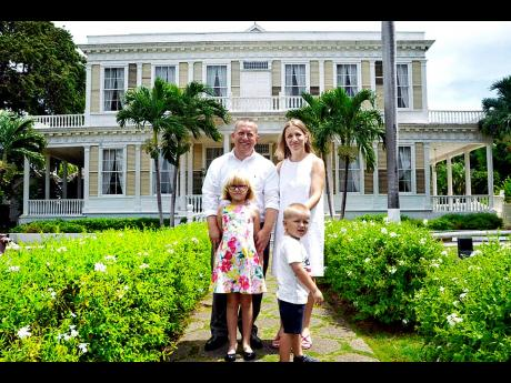 Father of two John McIntyre (left) enjoys an afternoon out at the iconic Devon House, alongside his wife, Flora Zylfijaja (right), and his two children, Emma and Ian.